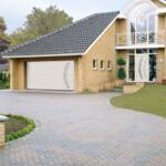 Modern house with double white steel door garage