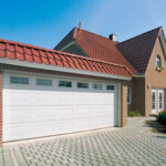 Double White Sectional Garage Door with glass panels at the top