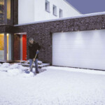 Contemporary house with double steel garage doors