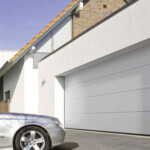 White steel double garage door with car outside