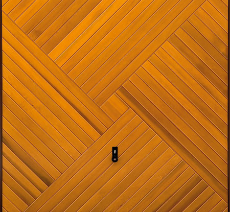 Timber interlocking shapes pattern up and over garage door