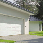 White panelled steel double garage door