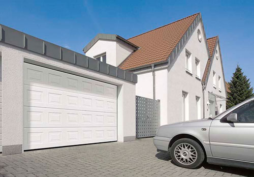 White steel garage door with silver car inside and silver car outside