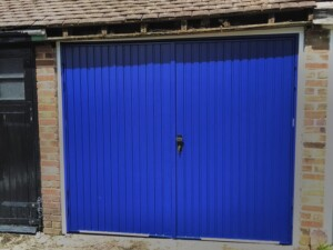 Steel side hinged garage doors manufactured by Cardale - After