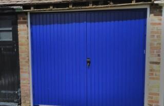 GRP Garage Door - white panelled timber effect door