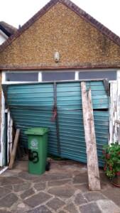 Before installation - the original broken door