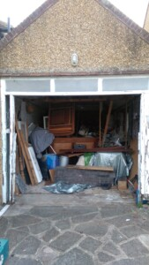 Looking straight at the garage with the old door removed