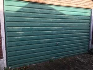 Before - old green garage door