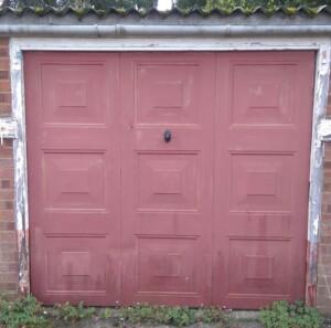 Before - an old brown garage door