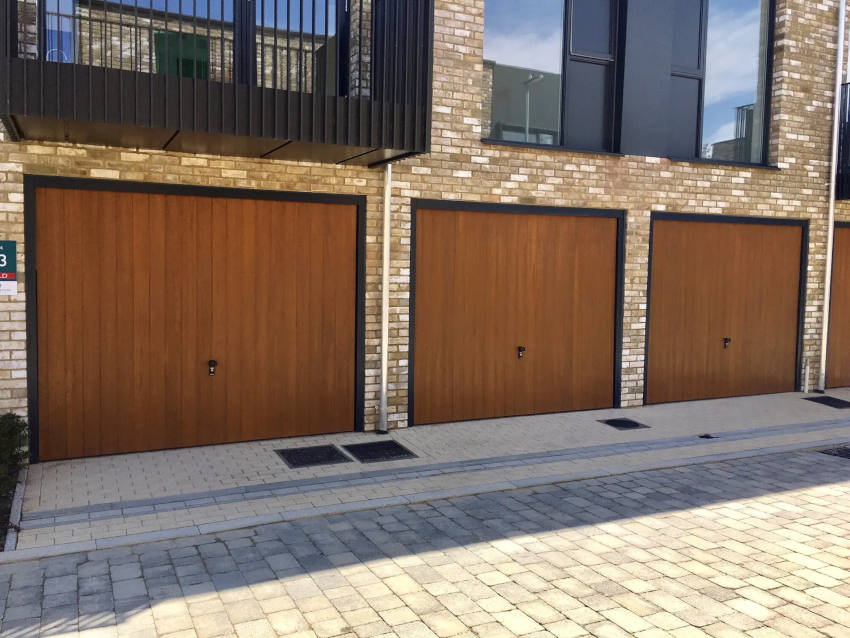 CDC GRP Garage Door Verwood Style in Honey Beech with anthracite grey frames and fully automated