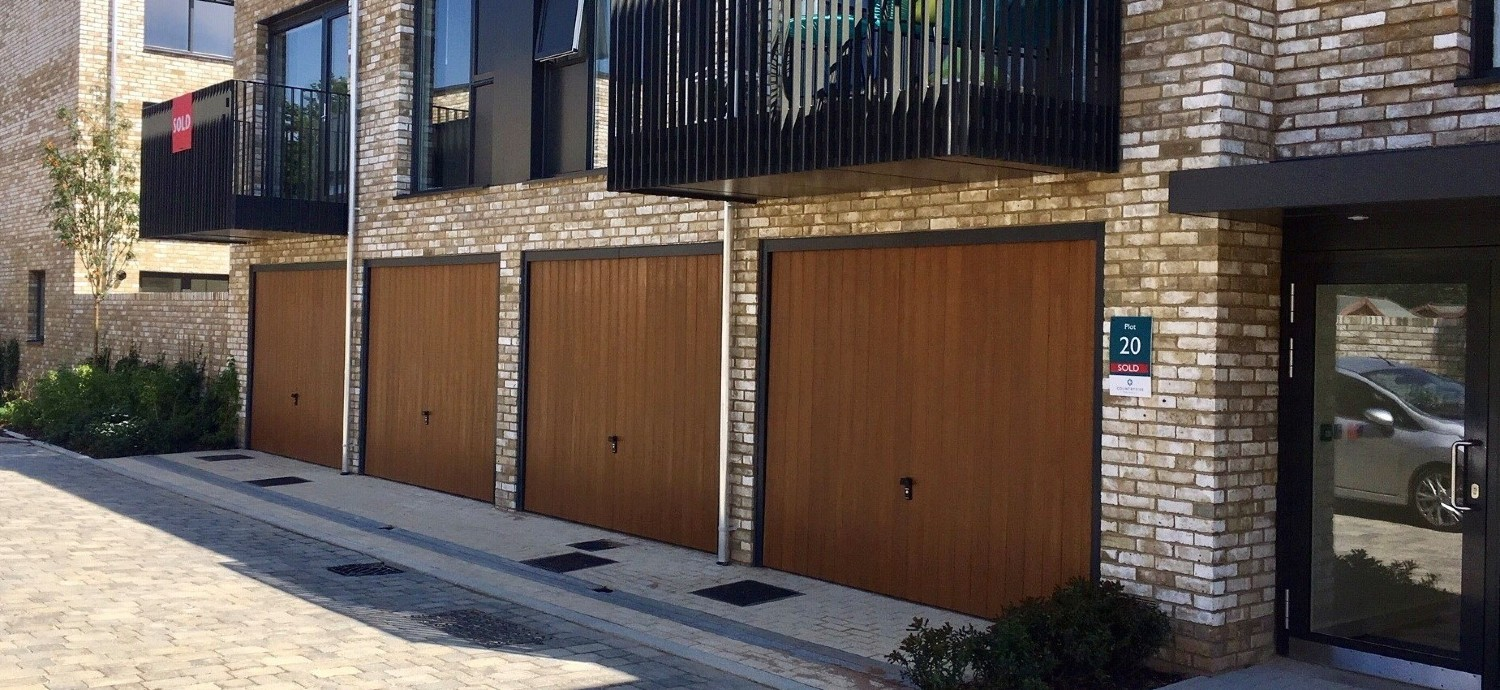 CDC-GRP-Garage-Door-Verwood-Style-in-Honey-Beech-with-anthracite-grey-frames-and-fully-automate