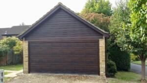 Wood effect coloured sectional garage door