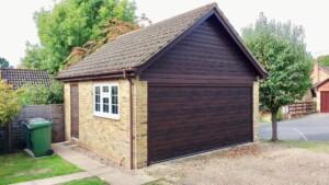 Detached garage with new sectional garage door