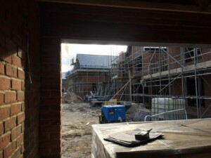 Looking out from a garage towards buildings