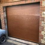 Novoferm Automatic Rollershutter Garage Door in Golden Oak