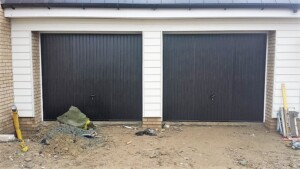 Black up and over steel 'Thornby' design garage doors by Novoferm