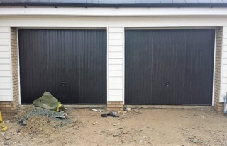 Image of house with twin garage and white steel doors
