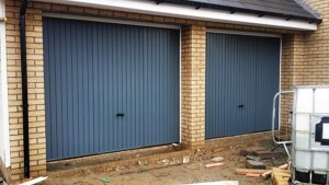 Grey up and over steel 'Thornby' design garage doors by Novoferm