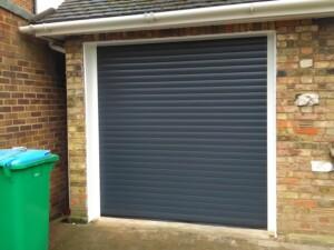 Black Novoroll garage door after installation