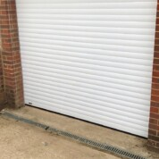 SWS Seceuroglide Classic white roller shutter garage door complete with electric operator