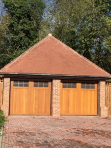 Double Garage with Novoferm's Leicester design doors in Light Oak