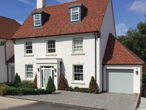 Diagonal Shot of White House with Verwood Agate Grey Garage Door