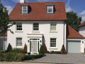 White House with Verwood Agate Grey Garage Door