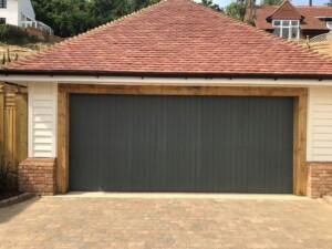 Black Verwood garage door on detached garage