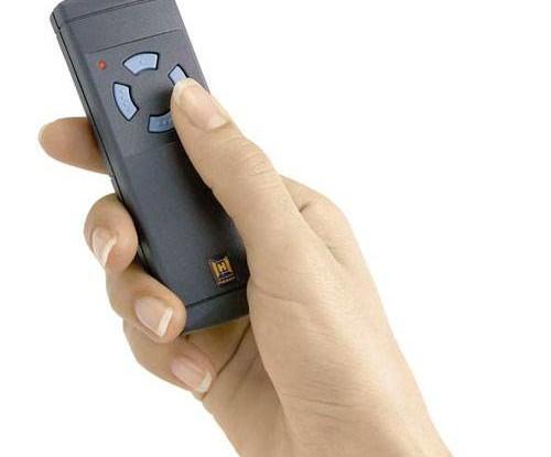 Automated Garage Door - hand holding remote control for door