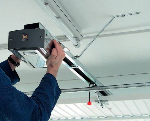 Workman installing automated garage door