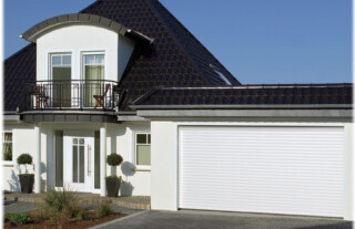 GRP Garage Doors - house with double garage and white GRP garage doors