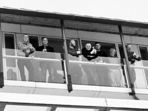 Black and White Image of the Team on a Balcony