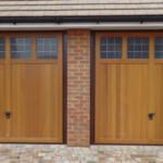Timber Up and Over Garage Door - twin doors with glass panels