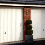 Up and Over Garage Doors - twin white doors