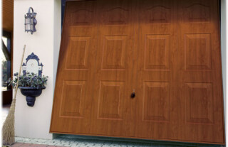 Up and Over Garage Doors - Wooden panelled up and over garage door slightly open